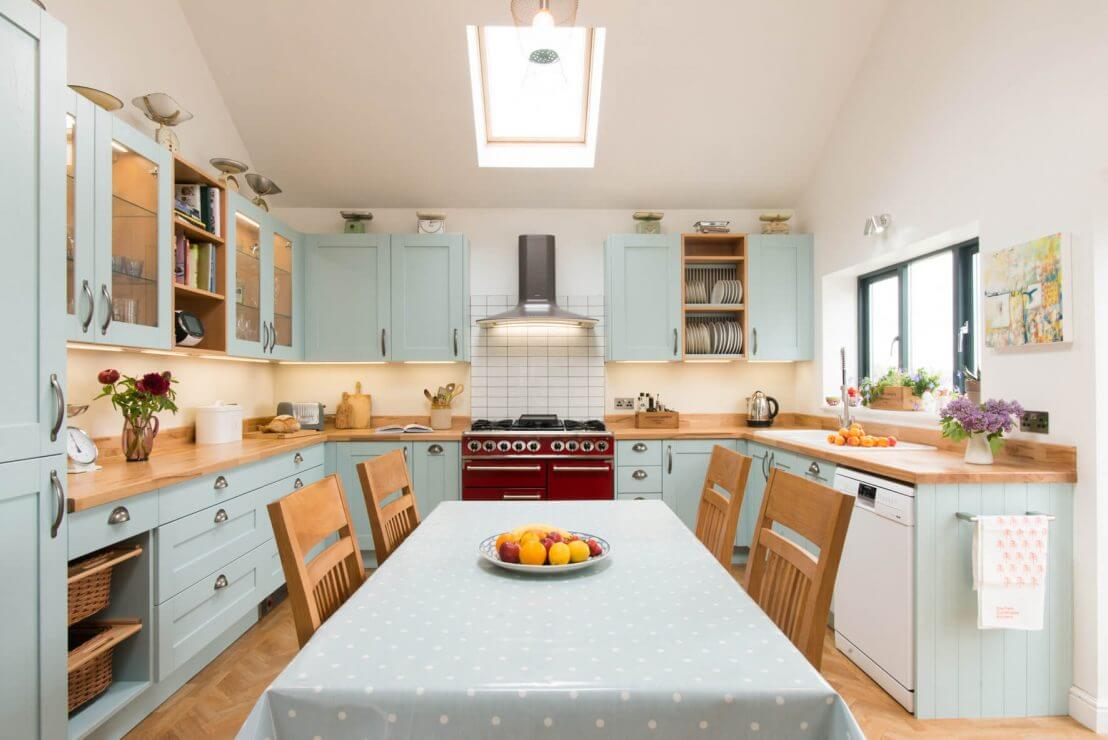 u-shaped new country kitchen with blue shaker doors