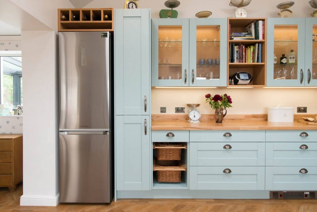 blue country kitchen with wicker basket drawers