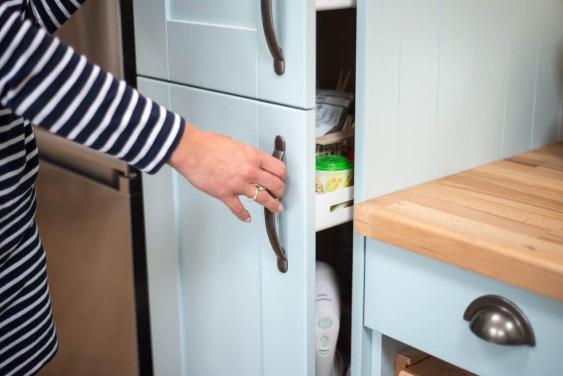 hand opening tall larder cabinet with blue doors