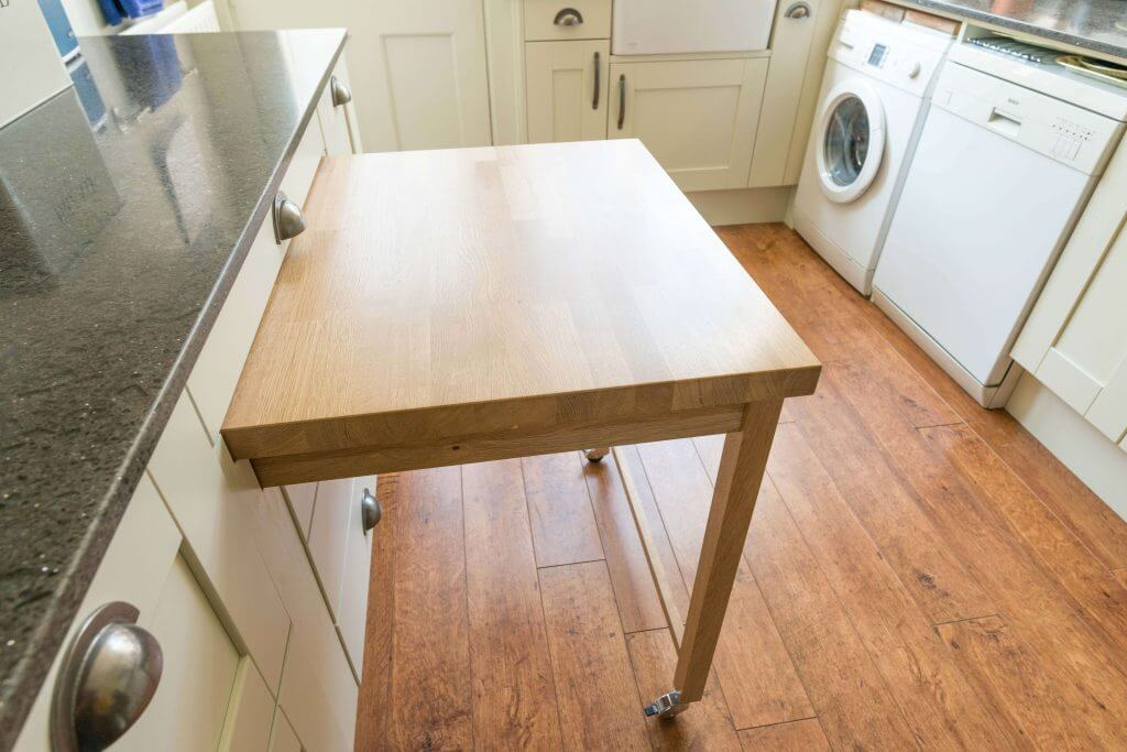 pullout table in compact kitchen