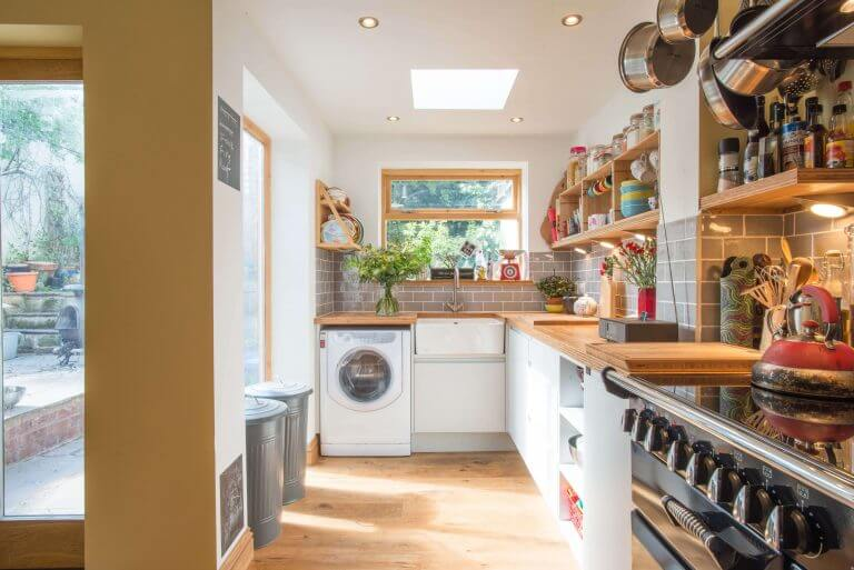 compact modern kitchen with bamboo worktop and open shelving
