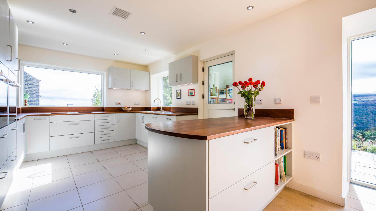 new kitchen with reclaimed timber worktops in mid century modern new kitchen