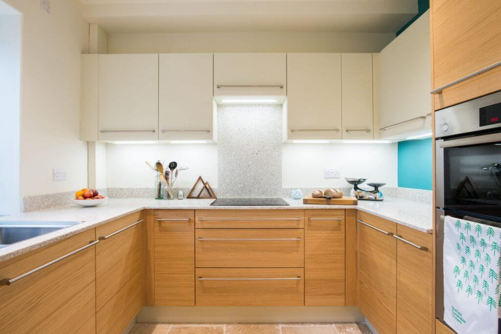 modern new kitchen with slab doors and recycled glass kitchen worktops