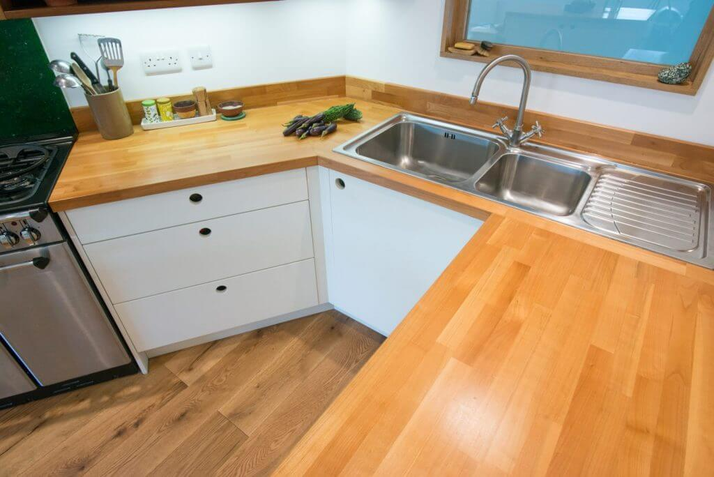 solid cherry timber worktop and stainless steel inset sink