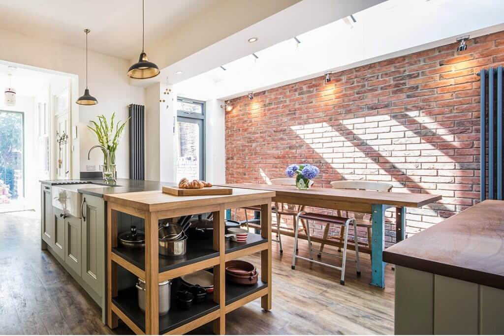 large victorian kitchen extenstion with large kitchen island and solid timber kitchen units