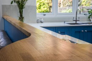 handmade oak feature breakfast bar in new kitchen