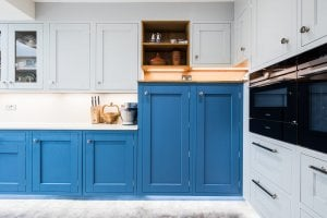 dark blue in-frame kitchen cabinets