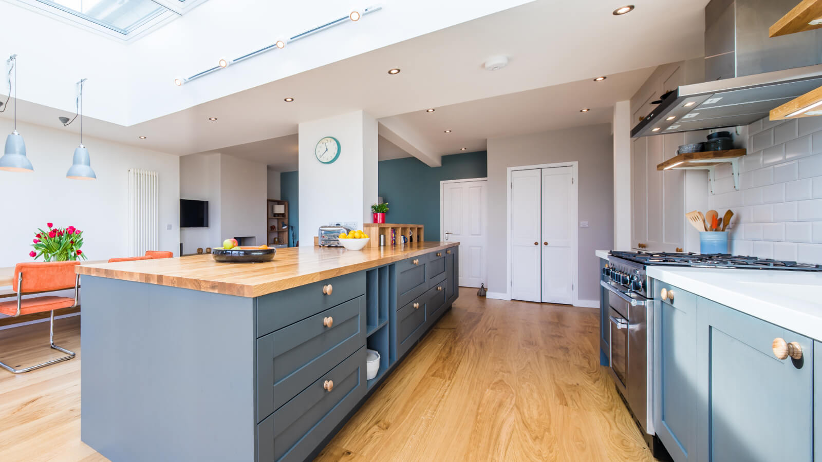 new oak kitchen with long kitchen island and breakfast bar