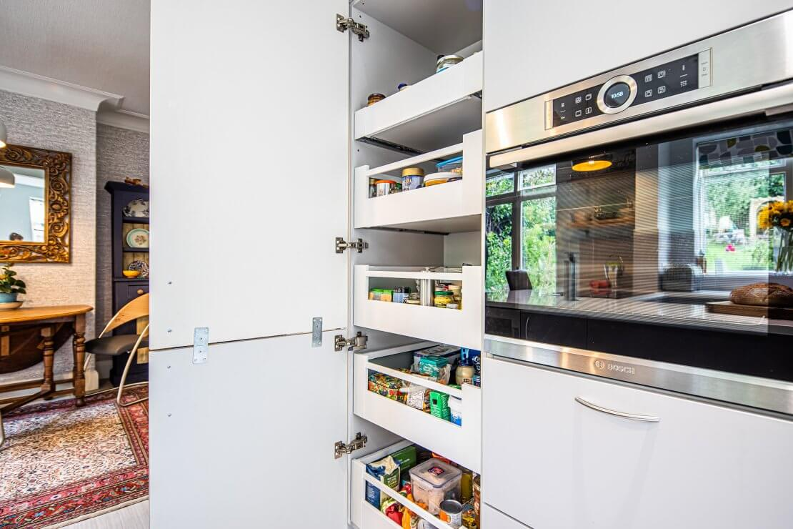 built in oven with kitchen storage and pull out larder drawers