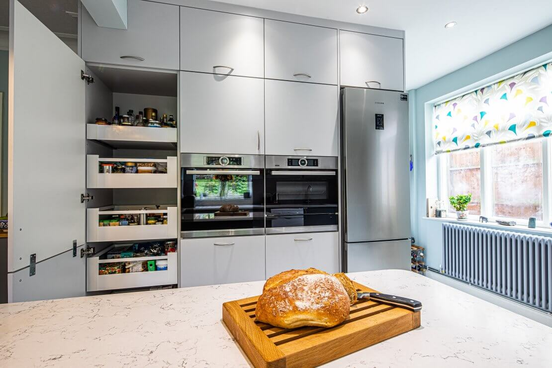double eye level ovens with space tower and large fridge freezer