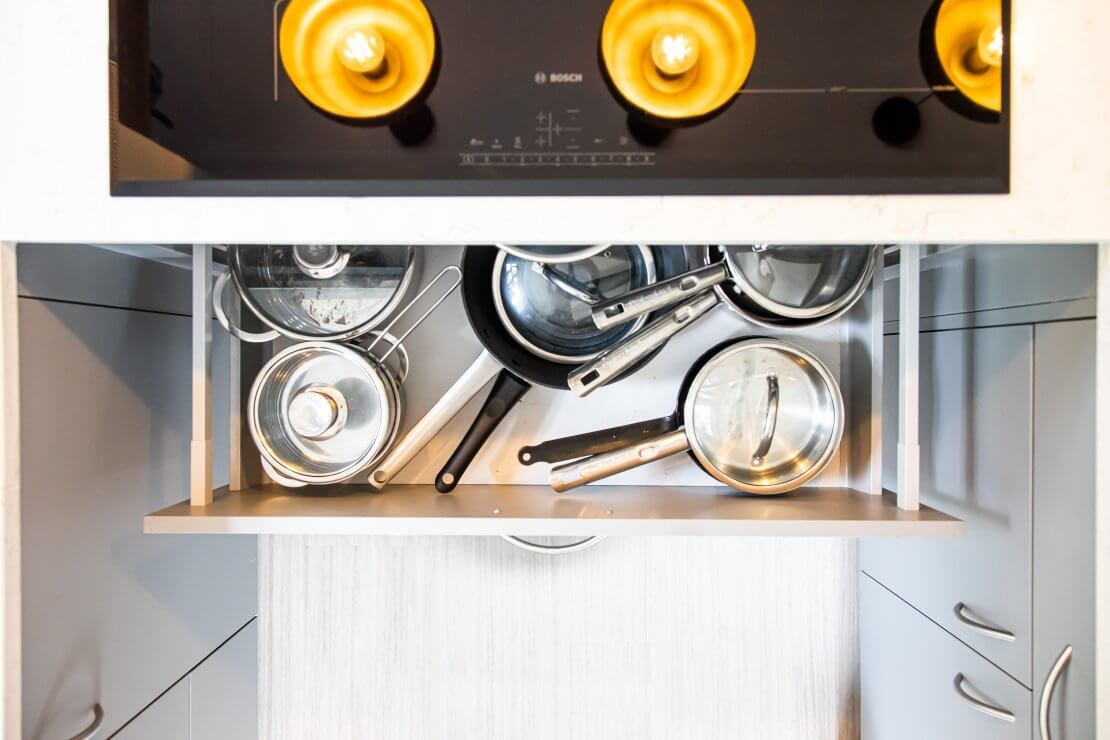 open pan drawer from above underneath induction hob