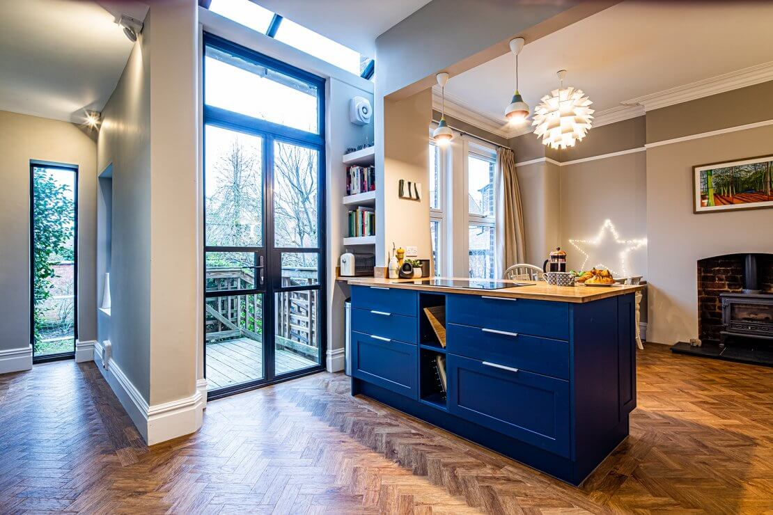 kitchen island in blue with solid oak worktop