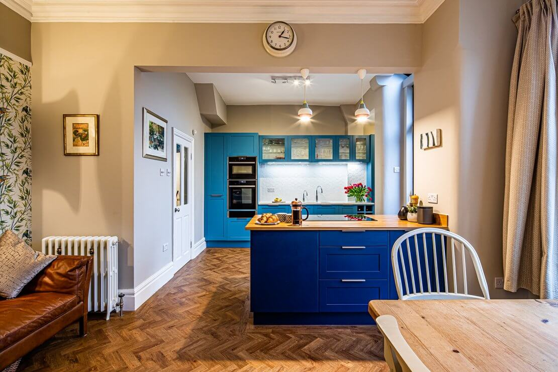 blue two toned kitchen with island in manchester
