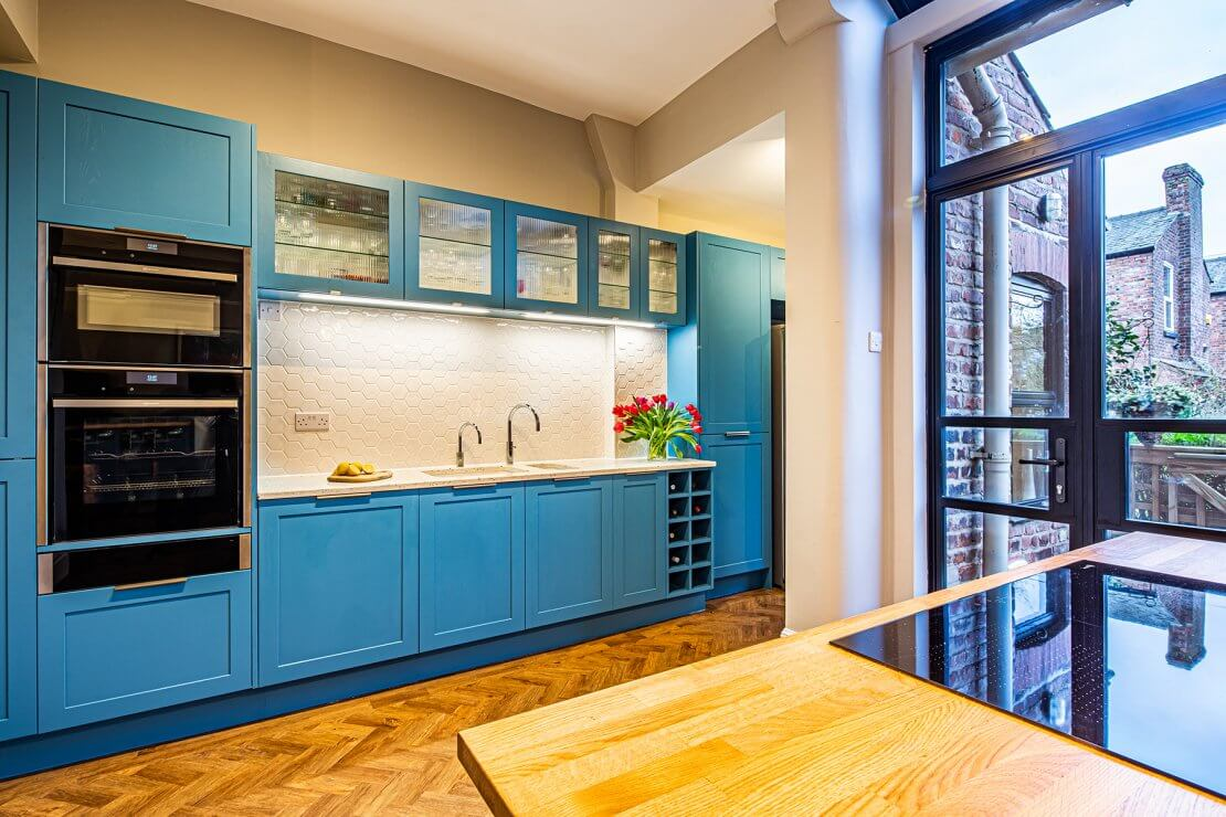 blue kitchen cabinets with integrated oven