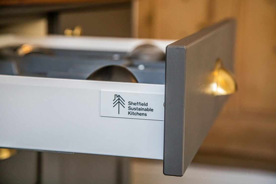 kitchen pull-out drawer with sheffield sustainable kitchens logo on the side