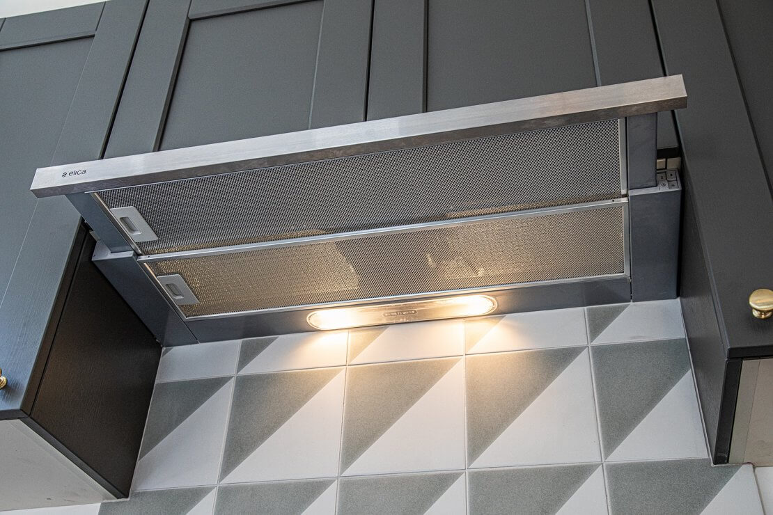 concealed kitchen extractor fan in grey kitchen