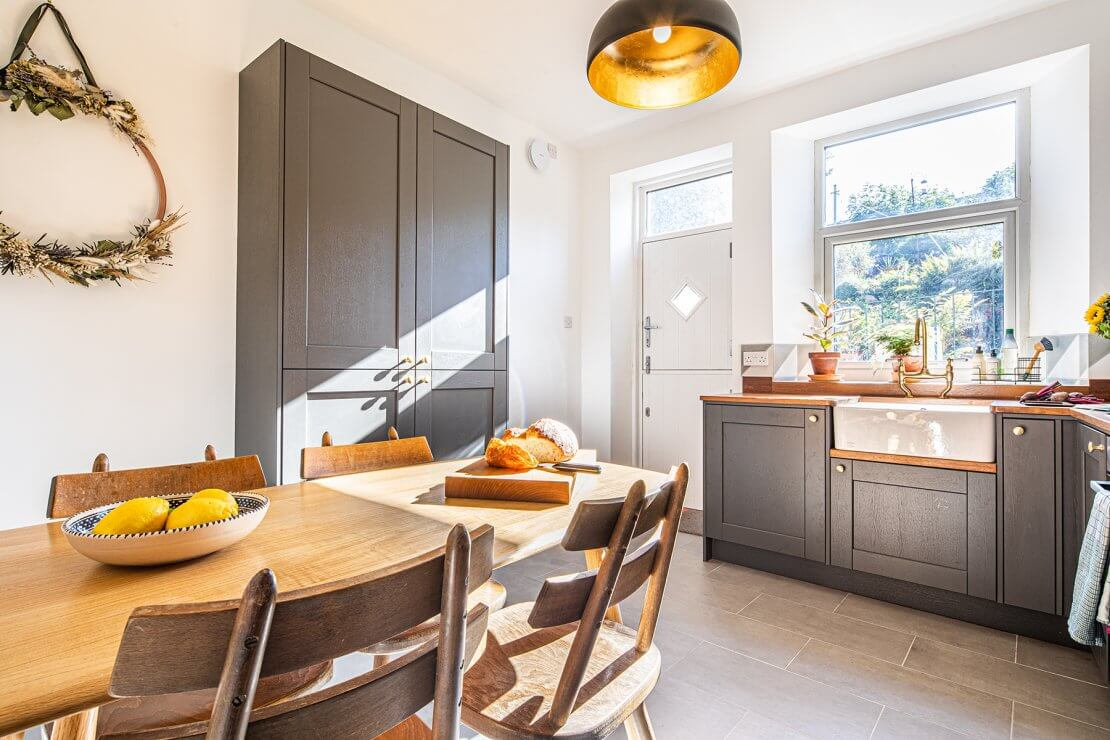 bright and sunny grey kitchen with larder