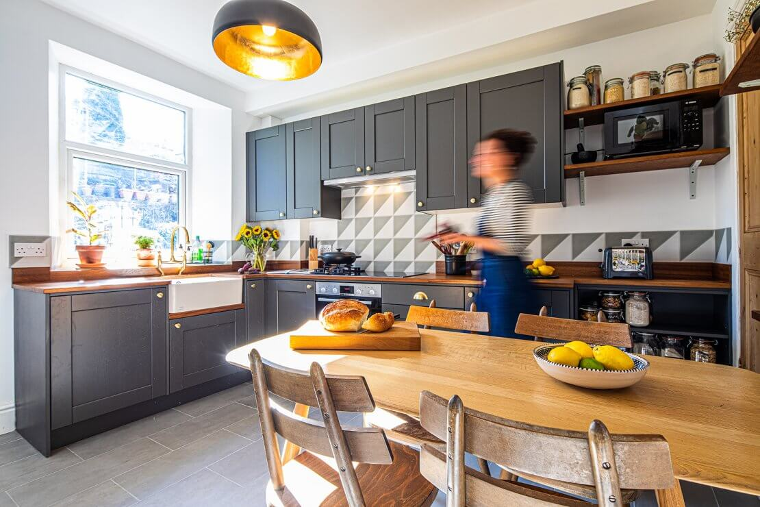 kitchen diner open plan with person walking through