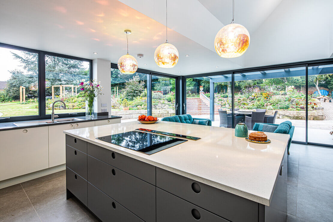 grey kitchen island with white quartz worktop