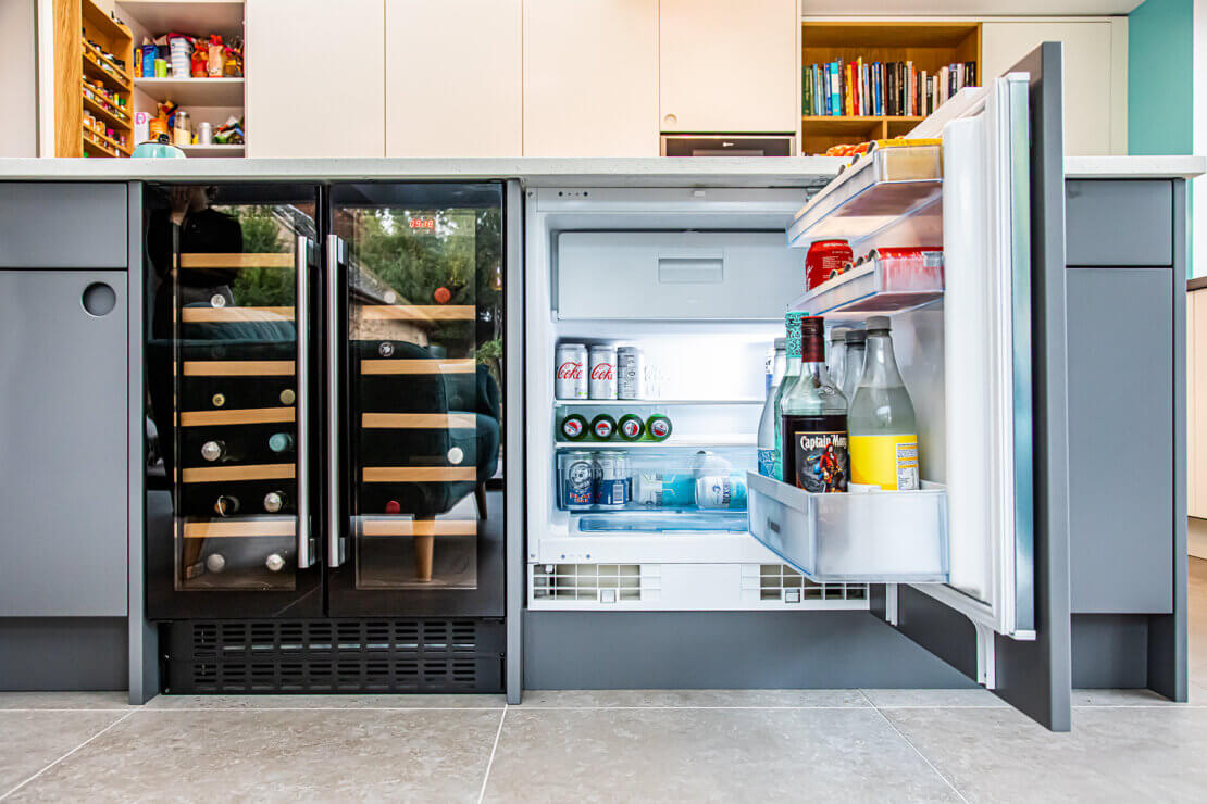 integrated fridge and wine fridge displaying drinks