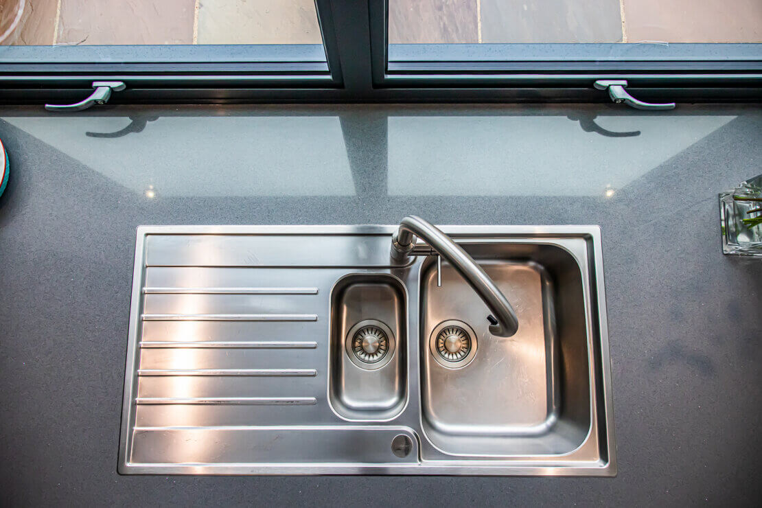 quooker boiling water tap and stainless steel sink in quartz worktop