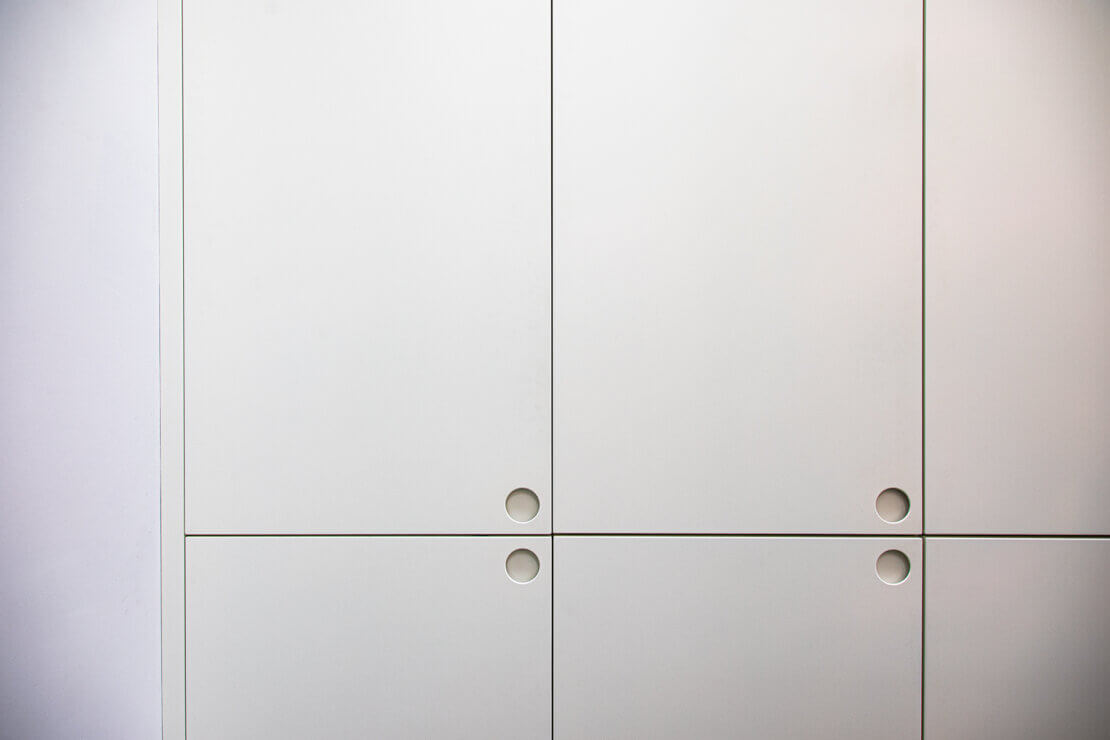 white kitchen cabinet doors with bespoke circular cut out handles