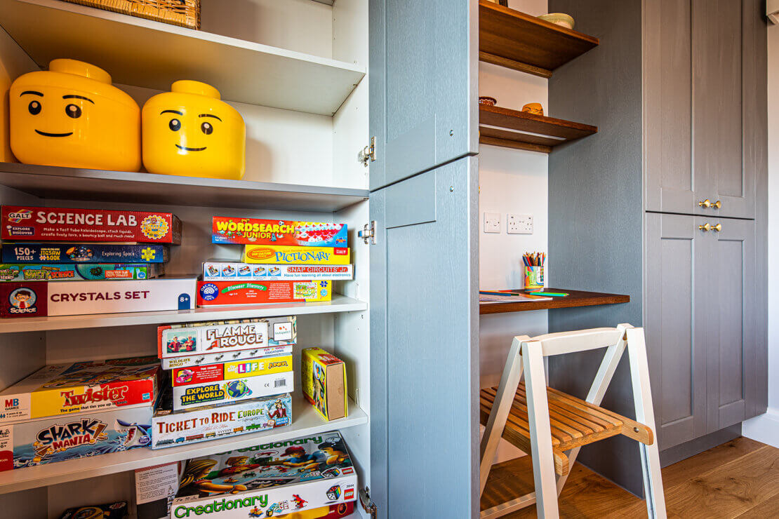 Childrens areas with bespoke homework bench and storage unit full of board games