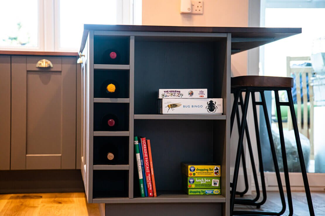 bespoke end cabinet storage with wine rack and cook book shelves