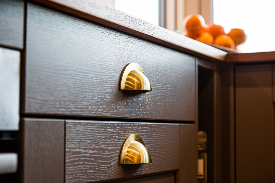 brass kitchen handles on grey shaker drawer fronts