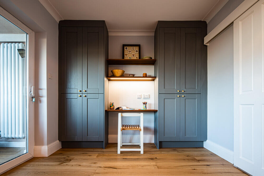 grey shaker cabinet storage with childrens homework bench and reclaimed timber shelving