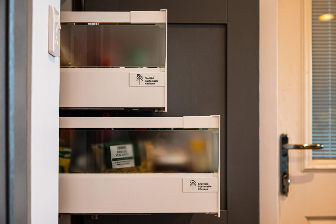 sheffield sustainable kitchens logos on the side of larder space tower drawers