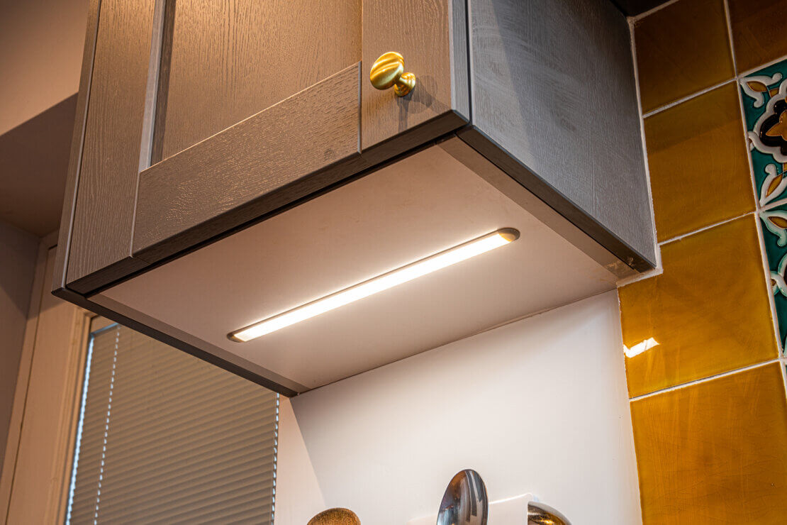 under cabinet lighting in grey shaker style cabinet door