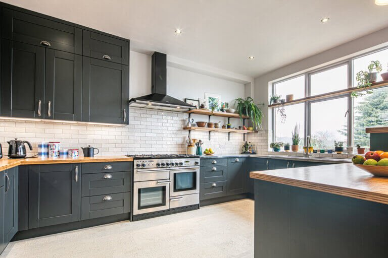 industrial and bold kitchen with stainless steel worktop and bamboo peninsula